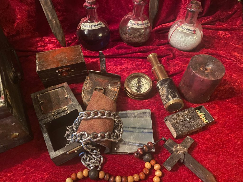 Vampire Killing Kit Neriah, contents, including compass, spyglass, rosary, stake, holy water, silver chain